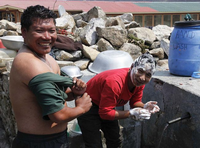 Lahar and Dorje washing in icy water