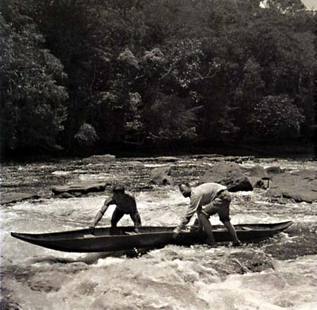 Schultes & friend hauling upstream, 1943