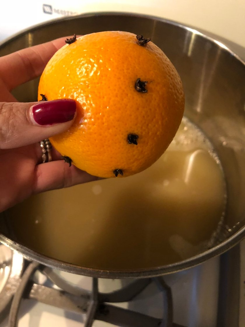 Stick the cloves in the orange like this