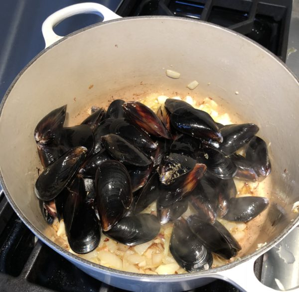 Mussels Added To Garlic, Shallots, Red Onion and Olive Oil