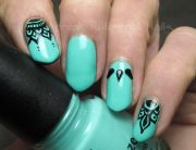 turquoise and black nail art