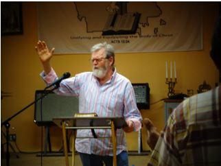 Pastor Don Randall preaching