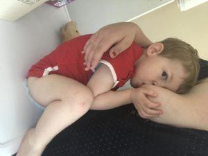 Toddler nursing on a tumble dryer. Nursing boundaries