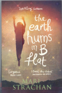 Cover of The Earth Hums in B Flat by Mari Strachan