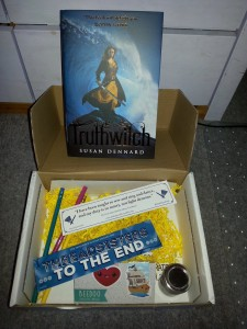 Photo of the second Illumicrate box, including the book Truthwitch and some extra goodies