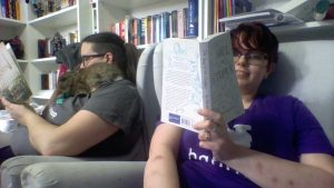 Photo of me and the wife reading, with bunny