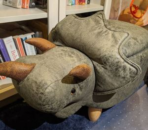 Photo of a triceratops-shaped footstool