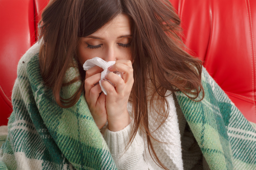 Close-up-of-ill-teenager-with-tissue