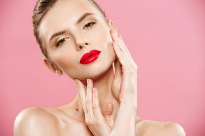 woman touching her face facial treatment