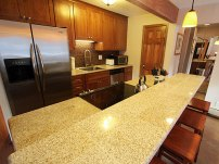 Remodeled kitchen with small appliances.