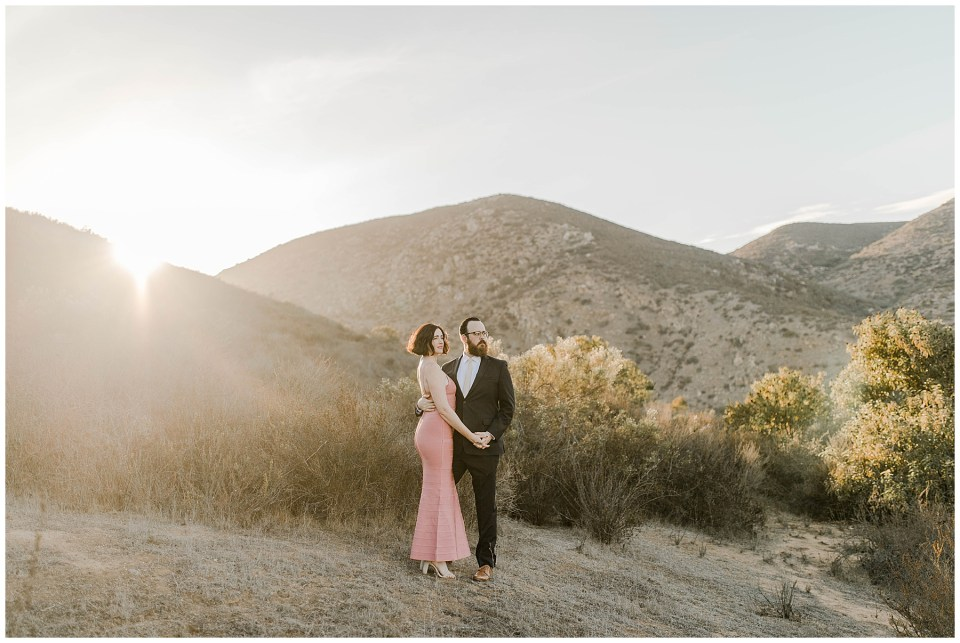 Romantic photos of a couple taking their engagement photos during sunset at Mission Trails Regional Park