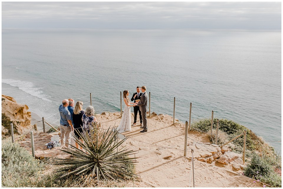couple holding hands at the alter at torrey pines state park