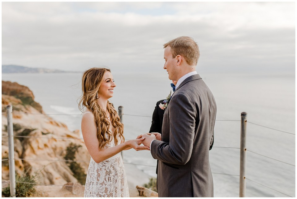 bride and groom look into each others eyes in la jolla beach california