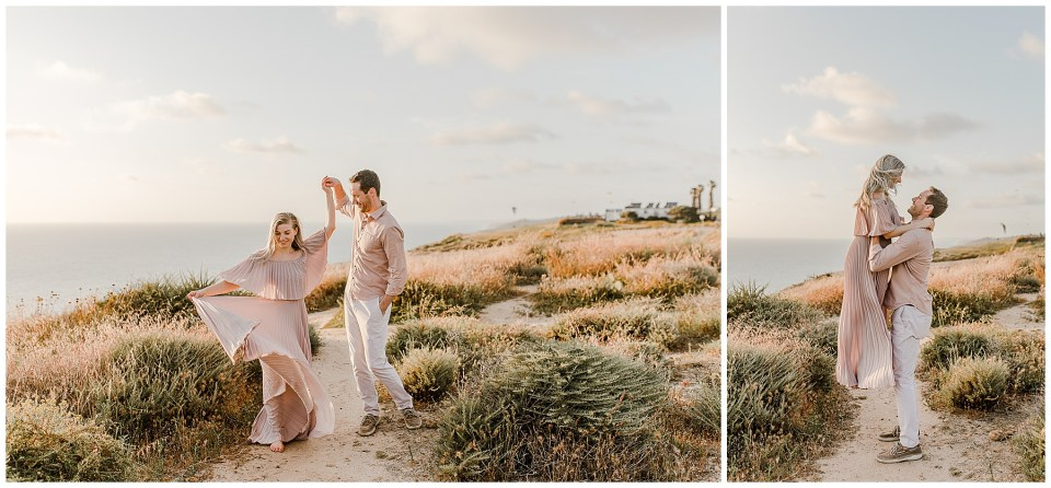 man and woman dancing during engagement photos in torrey pines gliderport