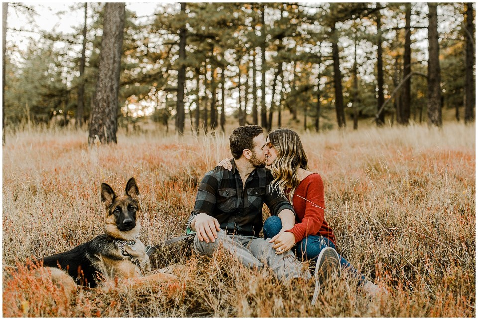 man and woman take pictures with their german shepherd during their Julian Fall Time Couples Session