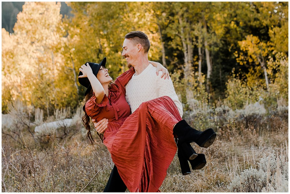 Man picks up his woman and spins her around on their Big Cottonwood Canyon Engagement