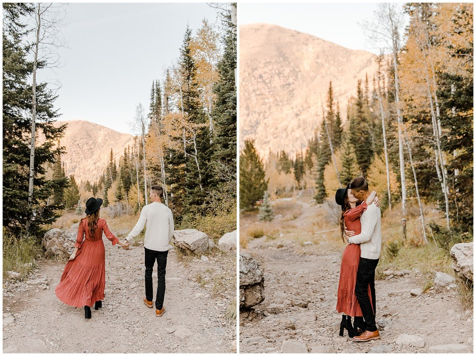 man and woman holding hands walking on a trail during their Big Cottonwood Canyon Engagement Session