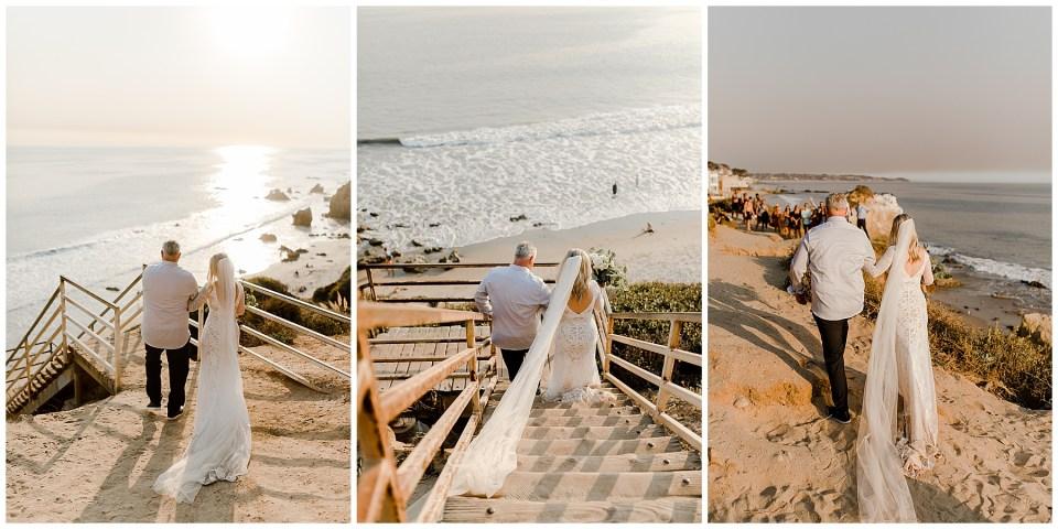 bride and father walk down the aisle at el matador beach in malibu