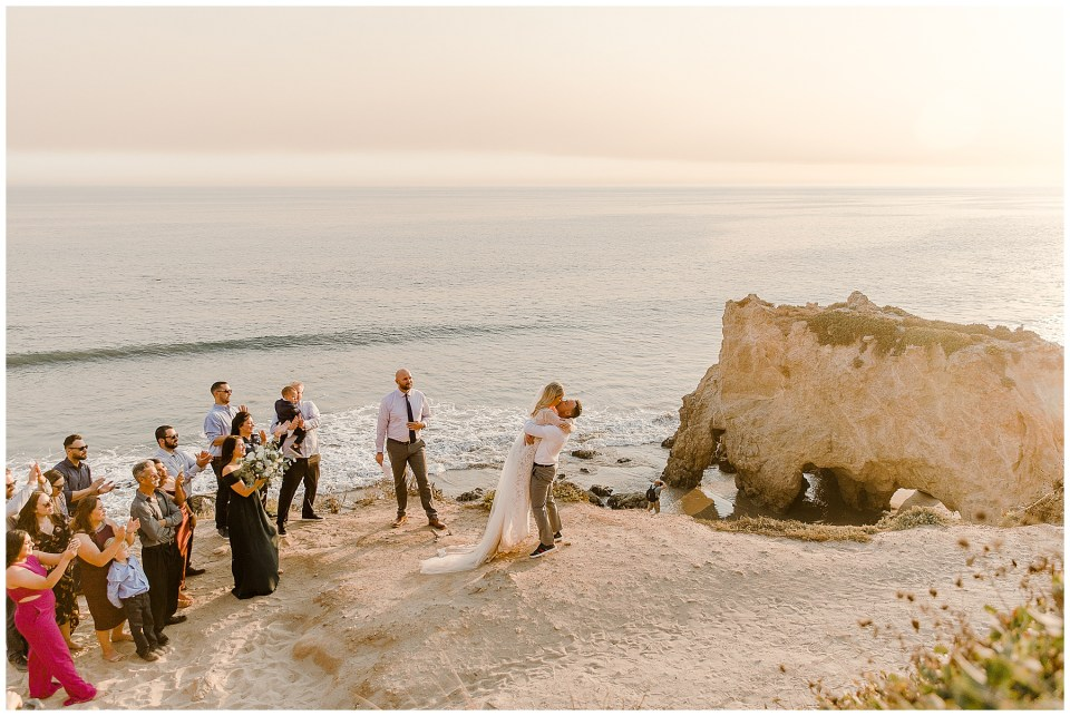 bride and groom first kiss during their el matador beach elopement