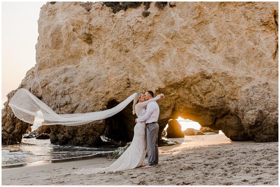 man and woman kissing during their el matador beach elopement