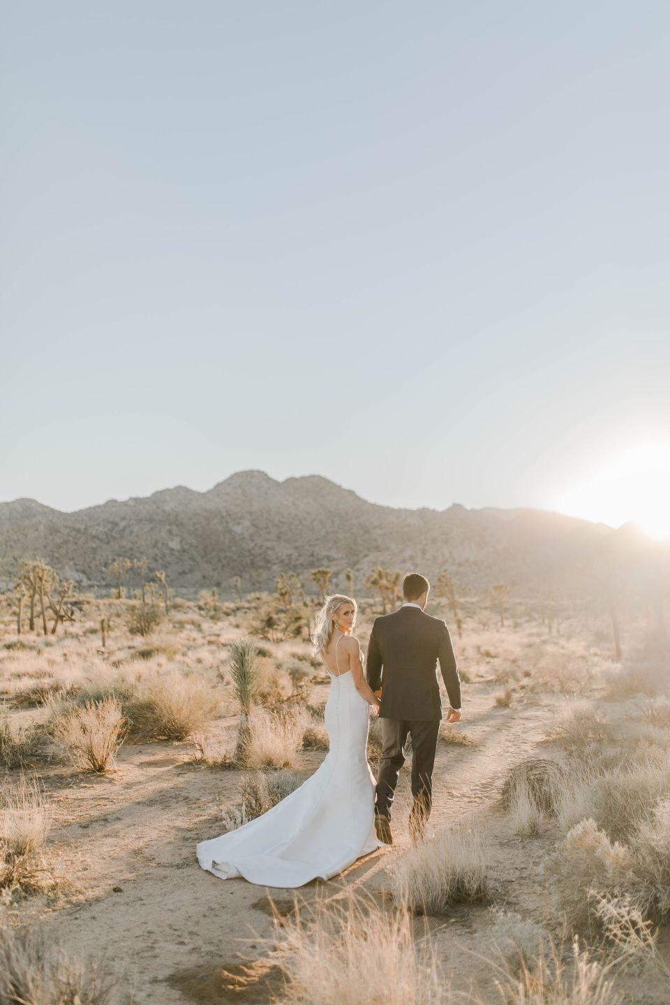 bride and groom taking pictures during a stunning joshua tree elopement
