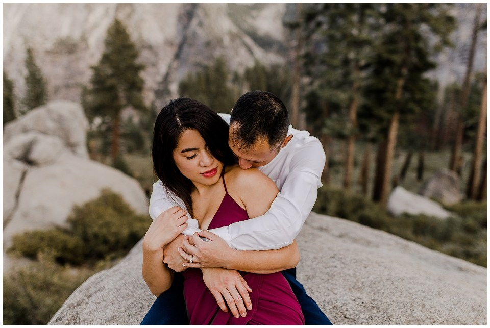 bride and groom sitting on a rock during their adventurous yosemite engagement session