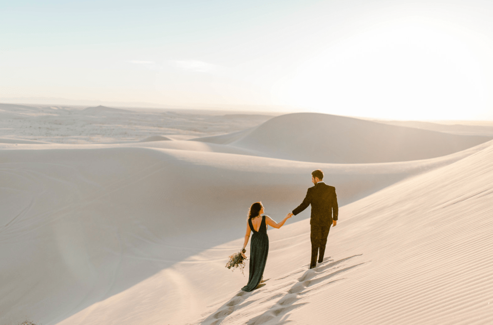 man and woman holding hands during their elopement in glamis sand dunes - Getting Instagram Worthy Photos in Glamis Sand Dunes