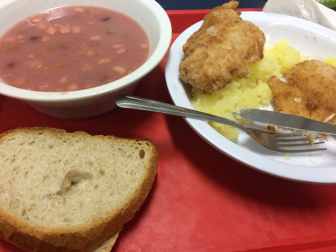 Fruit soup with breaded chicken and mashed potatoes.