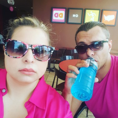 Nate and Breezer wearing pink while enjoying Dunkin Donuts