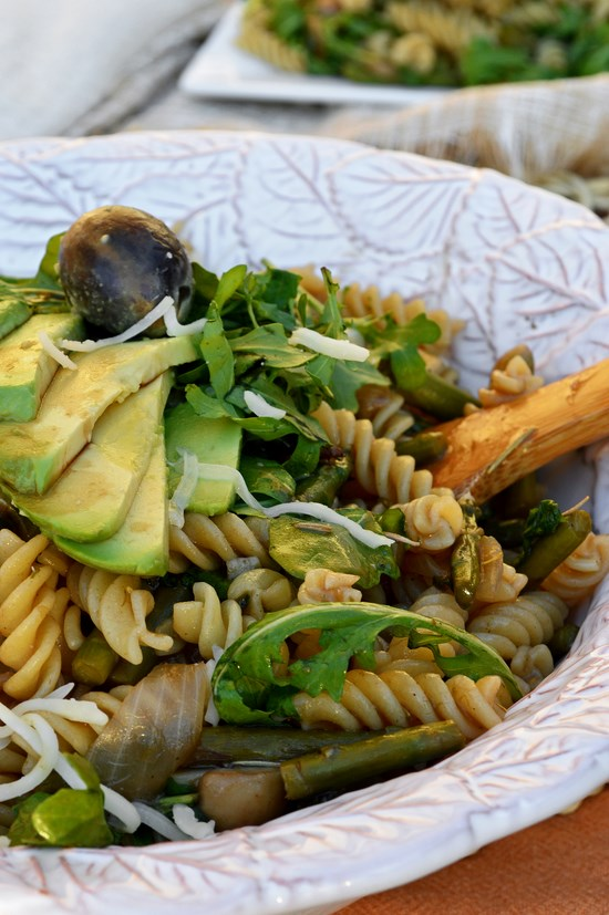 Gluten free rotini pasta cooked with asparagus and mushrooms and tossed in a rosemary balsamic sauce. Served with fresh arugula leaves, avocado slices and parmesan shavings for a healthy meal.