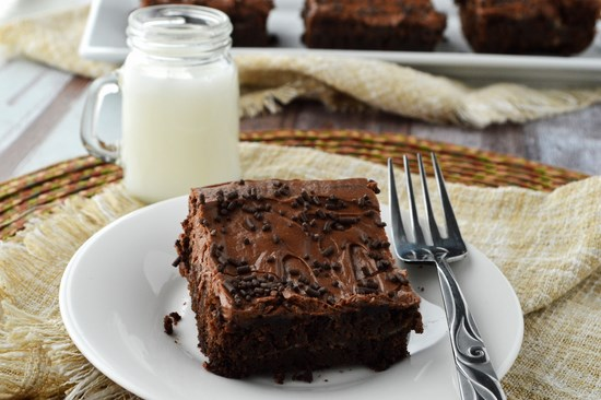 This Gluten Free Marbled Cream Cheese Brownie Cake is a mix between brownies and cake. A thick and fudgy gluten free chocolate cake marbled with swirls of cream cheese and topped with a slightly tangy sour cream chocolate frosting.