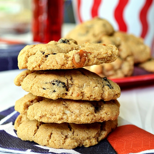 Soft and chewy Gluten Free Cinnamon White Chocolate Oatmeal Raisin Cookies make the perfect gluten free cookies year round. Serve these warm for a sensational treat.