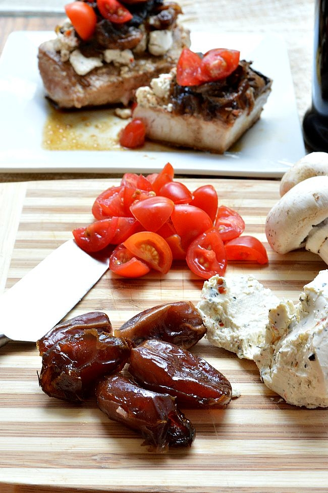 These Gluten Free Pork Chops with Goat Cheese and Caramelized Onion and Date Compote will wow your guests with little effort. It's sweet, tangy, and savory and perfect for a fancy weeknight meal.