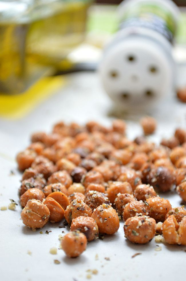 These Gluten Free Italian Parmesan Roasted Chickpeas are baked until crispy then tossed in olive oil with a mixture of Italian spices and Parmesan cheese. A great, healthy way to snack!