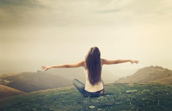 woman-breathing-on-mountain