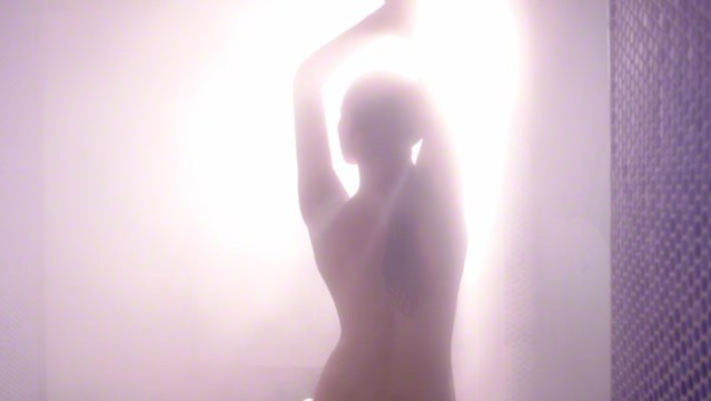 woman in steamy shower