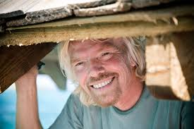 Sir Richard Branson smiling sweetly and enthusiastically