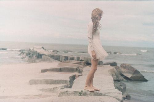 girl alone on rocks