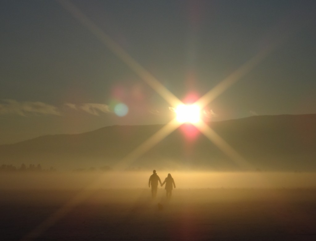 sunset-couple in mist