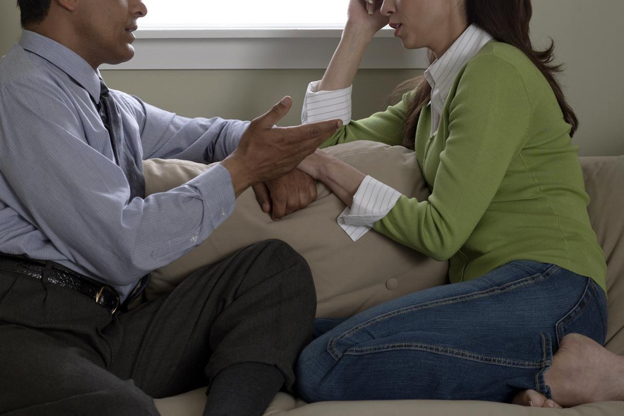 serious talk touching hands