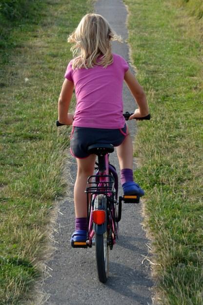 girl on bike path