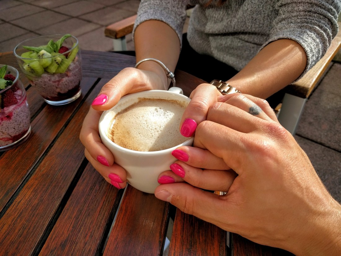 couple holding hands coffee