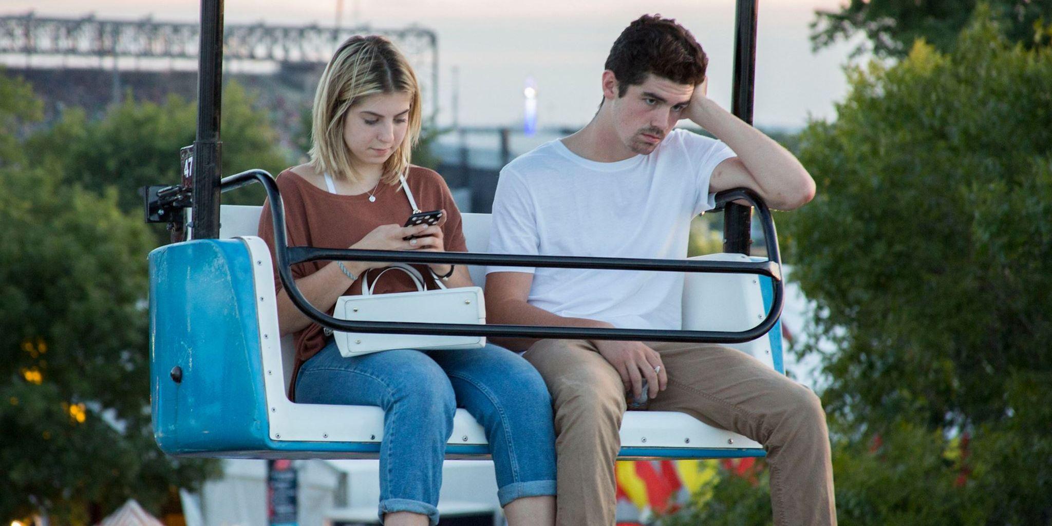 bored couple on ferris wheel