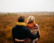 couple looking at meadow