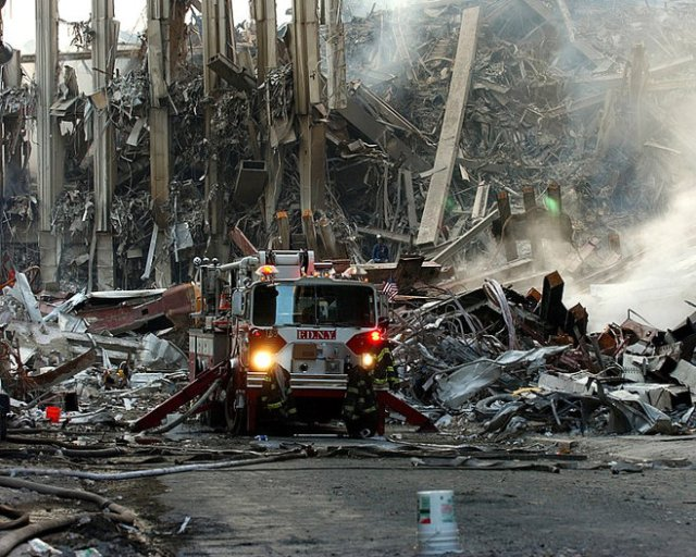 Photo of World Trade Center rubble and fires, by U.S. Navy Photographer's Mate 2nd Class Eric J. Tilford. (September 16, 2001)
