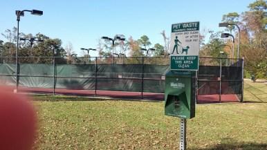 Poop Bag Dispenser on South side of Tennis Courts