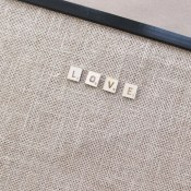 This sweet Scrabble burlap bulletin board spells LOVE (in Scrabble style letters) for your favorite room. Get some Pottery Barn inspired style at a fraction of the price (77% off) with this easy project from BrenDid.