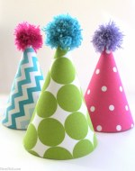 Fabric covered party hats are an easy craft and an affordable way to take your birthday party decor to the next level. With a little patterned fabric, glue, yarn and card stock you can turn a common party decoration into something extraordinary.