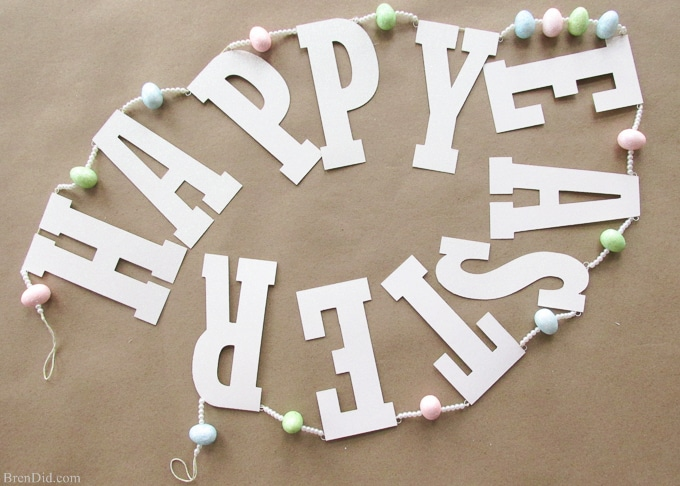 Pottery Barn Kids inspired glitter Happy Easter banner made from cardstock, twine, beads, and glitter styrofoam eggs. Takes only a few minutes to assemble and cost $4.00! Add a special touch to your Easter décor.