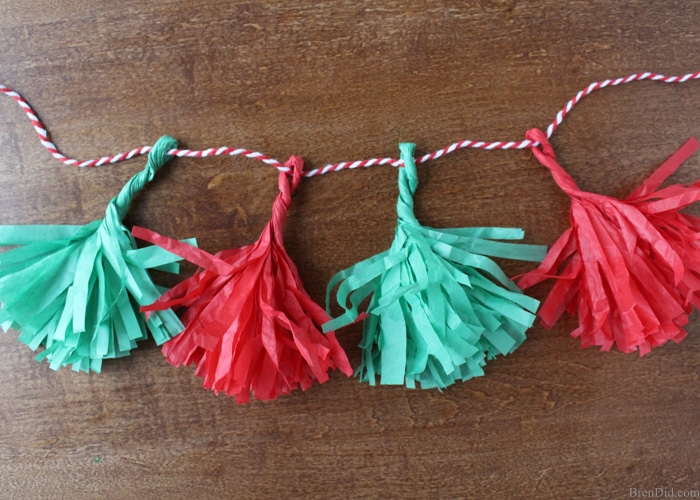 How to Make Tassels from Tissue Paper - Make your own free eco-friendly paper tassels for garlands and gift tie-ons using just tissue paper and scissors. They are a huge DIY trend and they are free by reusing tissue paper!